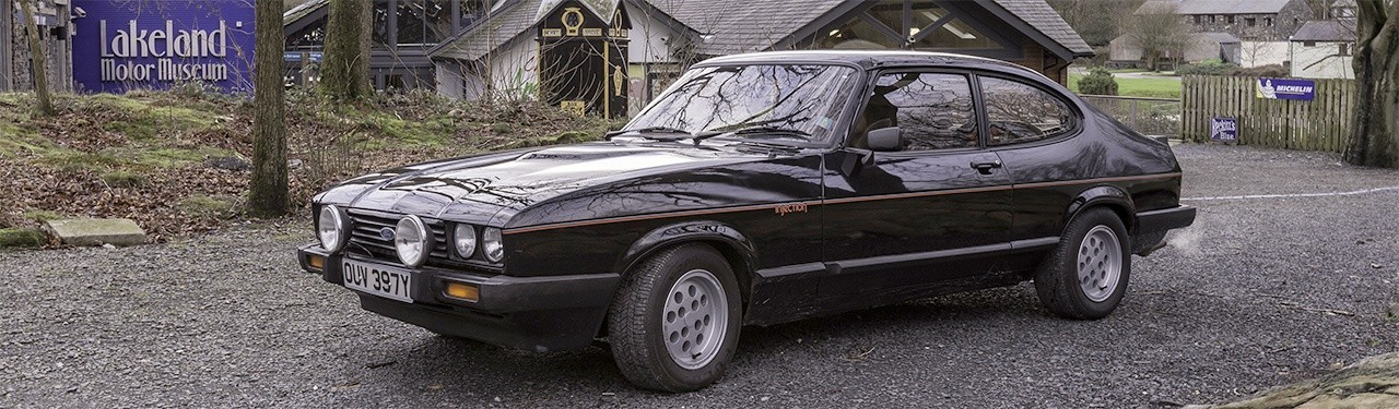 Photograph of 1982 Ford Capri outside museum building