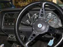 settering wheel, dials, dashboard and radio in the interior